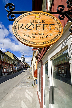 Wooden sign hanging outside a shop in Roeros, iron mining town, UNESCO World Heritage Site, Sor-Trondelag, Norway