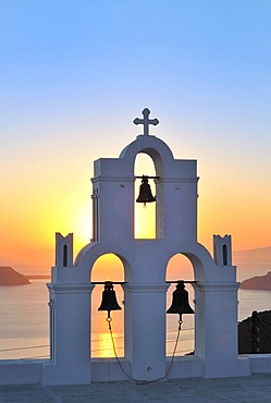 White Greek church with a blue dome and a bell tower at sunset, Firostefani, Santorini, Cyclades, Greece, Europe ***RESTRICTION: Not to be used for the travel industry (books, guides, brochures) in France between 1st of March 2011 and 31st of August 2011*