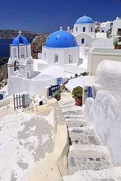 Stairs leading to a blue and white domed church and bell tower, Oia, Ia, Santorini, Cyclades, Greece, Europe