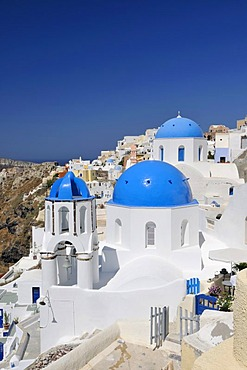 Blue and white domed church and bell tower, Oia, Ia, Santorini, Cyclades, Greece, Europe