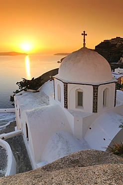 White domed church with a cross at sunset, Thira, Fira, Santorini, Cyclades, Greece, Europe