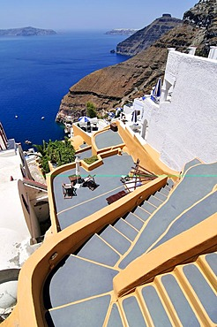 Stairway to the terrace of a small hotel in front of the inner side of the caldera with a steep drop to the blue sea, Thira, Fira, Santorini, Cyclades, Greece, Europe