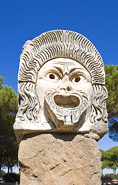 Comical masks at the amphitheatre at Ostia Antica archaeological site, Rome, Italy, Europe