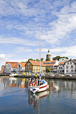 Sailboat in the harbour with Valbergtarnet, the former fire watch tower in the background, Stavanger (European Capital of Culture 2008), Norway, Europe