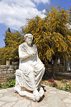 Statue of philosopher in front of the museum in Gortys. Crete, Greece, Europe