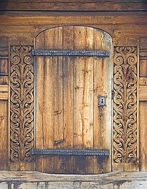 Carved wooden portal, Heddal Stave Church (Heddal Stavkirke), thirteenth-century stave church in Norway, Scandinavia, Europe