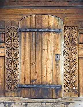 Carved wooden portal, Heddal Stave Church (Heddal Stavkirke), thirteenth-century stave church in Norway, Scandinavia, Europe