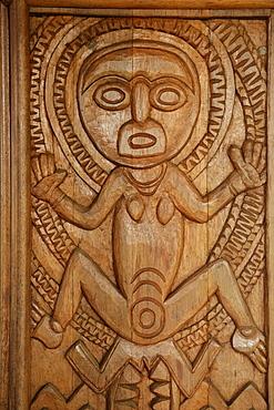 Woodcarvings at the entrance of the university library, Goroka, Papua New Guinea, Melanesia