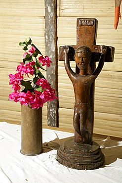 Crucifix, traditionally carved wooden figure of Christ on an altar, Mindre village, Papua New Guinea, Melanesia