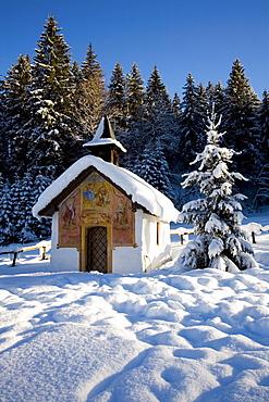 """Lueftlmalerei"" (religious facade paintings) on a chapel with Christmas tree, Elmau near Klais, Mittenwald, Upper Bavaria, Germany, Europe"