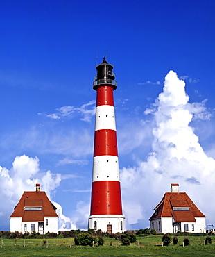Westerheversand Lighthouse with interesting cloud formations, Westerhever, Eiderstedt Peninsula, Schleswig-Holstein, Germany, Europe