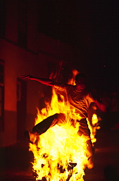 Man is jumping over a fire during the festival (Fiesta) de San Marco in Agulo, La Gomera, Canary Islands, Spain