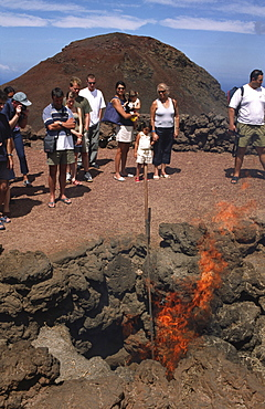 Demonstration of the geothermal energy in the National park Timanfaya, Lanzarote, Canary Islands, Spain