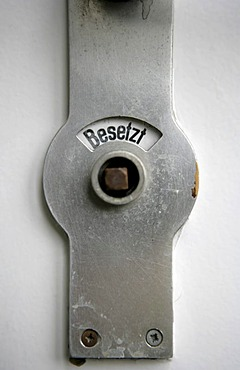 Toilet door. Occupied