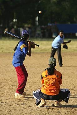 Young women playing baseball, Cochin, Kerala, India