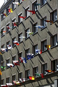 House with many international flags in the Reichsstrasse, Leipzig, Saxony, Germany