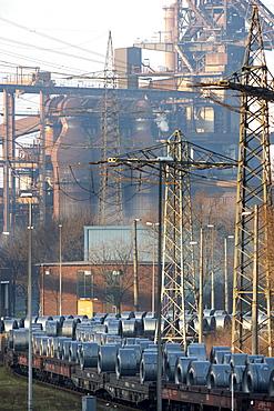 Freight train carrying a load of strip steel rolls, ThyssenKrupp Steelworks, Duisburg, North Rhine-Westphalia, Germany, Europe