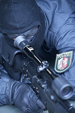 DEU, Germany: Sniper. Police SWAT Team, for arresting armed and dangerous criminals. They are specialists for rescuing hostages. They have special weapons and equipment.
