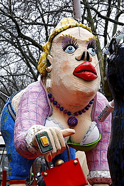 Busty paper-mache woman with collagen and botox needles sticking in her lips and face, Carnival (Mardi Gras) parade in Duesseldorf, North Rhine-Westphalia, Germany, Europe