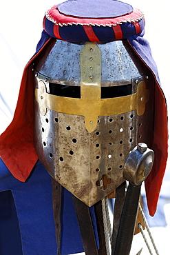 Knights helmet with eye slits decorated with colourful headband, knights camp, Flachsmarkt Burg Linn, Krefeld, Lower Rhine, North Rhine-Westphalia, Germany, Europe