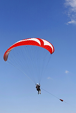 Paraglider hanging on the towrope, Lower Rhine, NRW, Germany
