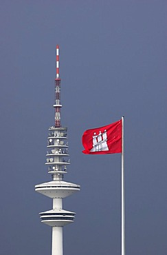 Flag of the city of Hamburg in front of the television tower in Hamburg, Germany