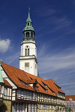 Tower of church Stadtkirche towers above the timbered houses of old town Celle, Lower Saxony, Germany