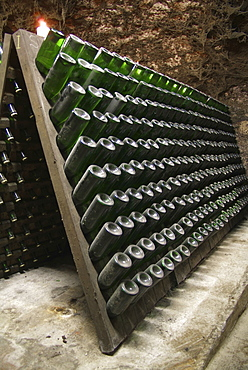 Wooden shelves for storing champagne bottles during the fermentation process in an old vault cellar, Kessler sparkling winery, Esslingen, Baden-Wuerttemberg, Germany, Europe