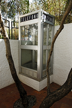 Telephone booth in barbecue area in the garden at the former home of surrealist painter Salvador Dali and his wife Gala in Port Lligat, Province Girona, Spain