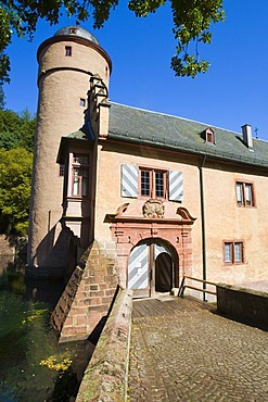 The moated castle Mespelbrunn is located in a remote side valley of the Elsava valley in Spessart, Bavaria, Germany.