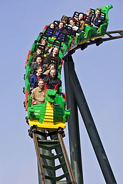 Teenagers riding a roller coaster