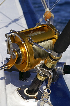 Sea fishing rod on a fishing boat, Mauritius, Mascarenes, Indian Ocean