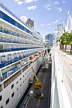 "Passenger cruise liner ""Diamond Princess"" being loaded, docked in front of the Pan Pacific Hotel in Vancouver, British Columbia, Canada, North America"