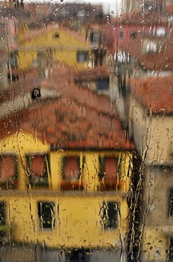 View of houses through a window with rain drops, Venice, Italy, Europe