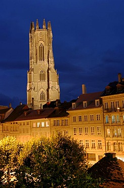 View over the roofs of old town buildings towards the Cathedral Saint Nicholas, Fribourg, Switzerland