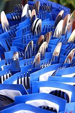 Cutlery wrapped in blue serviettes in a restaurant, Nuremberg, Middle Franconia, Bavaria, Germany, Europe