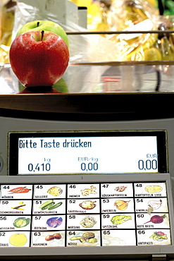 Apples on a supermarket scale (produce scale)