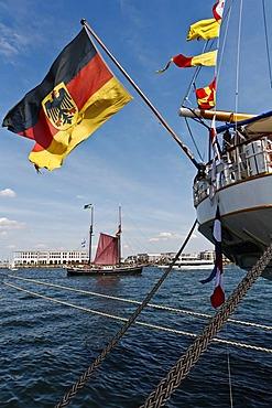 Flag of Germany, sailing boat, view of the Hohe Duene, beach resort, Warnemuende, Mecklenburg-Western Pomerania, Germany, Europe