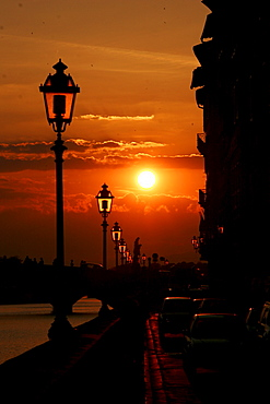 Lanterns at the waterside of the Arno, sunset, Florence, Tuscany, Italy