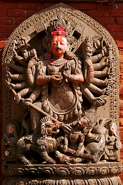 Statue of a multiple-armed god, Durbar Square, Bhaktapur, Nepal, Asia