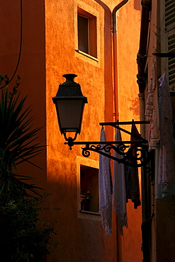 Lamp and laundry in a narrow lane in the historic centre of Nice, Cote d'Azur, France, Europe