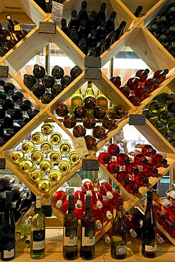 Shelf filled with wine bottles