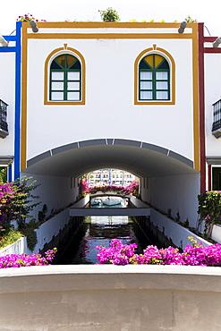 Canal thoroughfare under residential building, Puerto de Mogan, Gran Canaria, Canary Islands, Spain