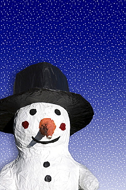 Tinkered snowman, pasted board