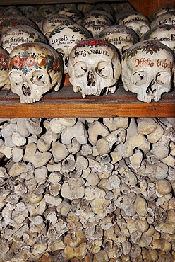 Skull skulls paint ossuary charnel house Hallstatt, Salzkammergut, upper Austria, Austria