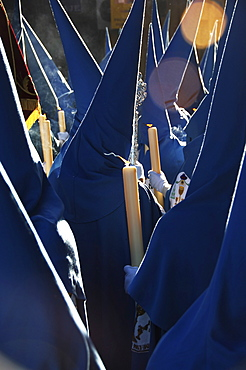 Penitents dressed in blue penitential robes (nazareno), Semana Santa, Holy Week Procession, Seville, Andalusia, Spain