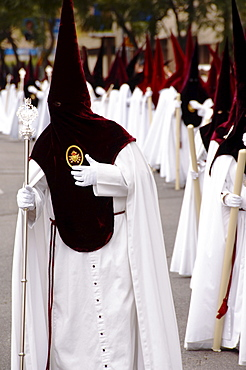 Penitents dressed in penitential robes, nazareno, Holy week procession, Semana Santa, Seville, Andalusia, Spain