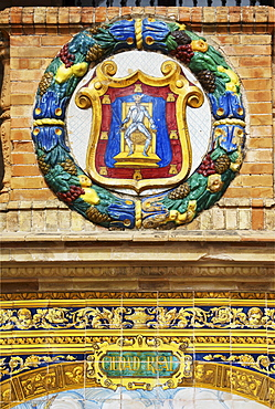 Emblem of Ciudad Real on the palace Palacio de Espana, Seville, Andalusia, Spain