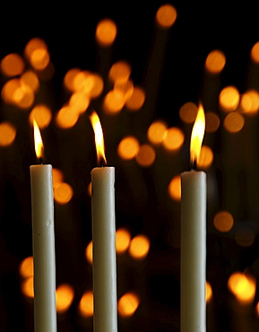 Votive candles in the side chapel of the church in El Rocio, Andalusia, Spain, Europe