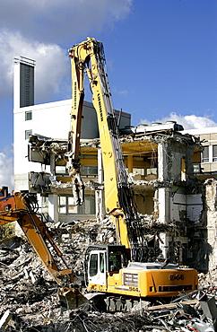 Wrecking excavator at a demolition site